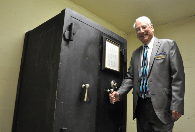 """Director of operations Jay Hill shows off the original Railroad Pass Hotel and Casino safe, which has not been opened in more than half a century. """"We don't have the combination so nobody knows wh ..."""