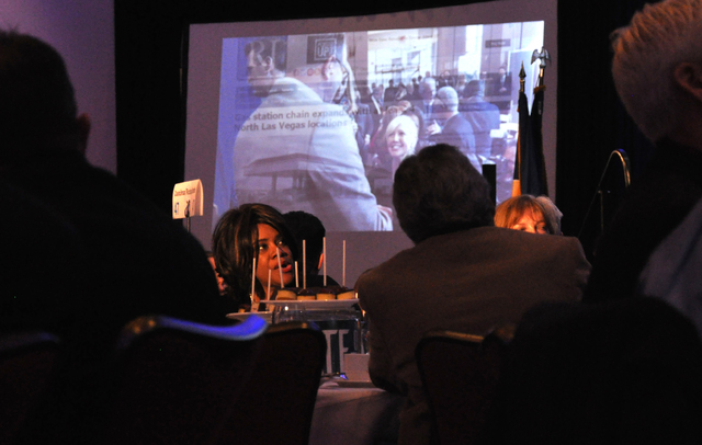 Guests watch video presentations highlighting the economic progress of North Las Vegas during the State of the City address, Jan. 26 at the Aliante Hotel and Casino.   Photo by Buford Davis / Las  ...