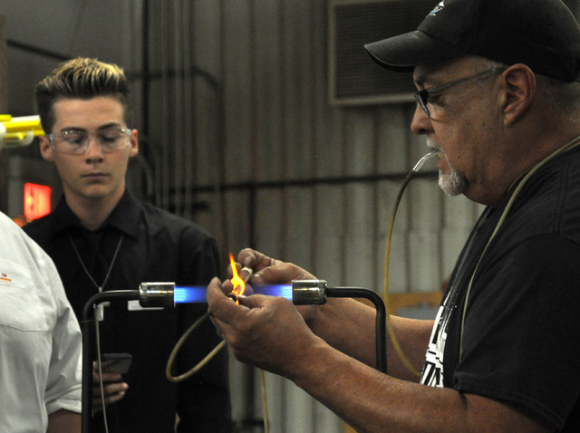 YESCO neon tube bender Eric Elizondo demonstrates glass working methods for students at SECTA as part of the FutuReady program, Oct. 26. Photo by Buford Davis | Business Press