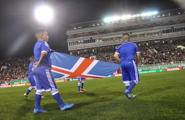 Children bear the Nordic Cross of Iceland prior to the nation's soccer friendly against Mexico at Sam Boyd Stadium, Feb. 8 Photo by Buford Davis / Las Vegas Business Press