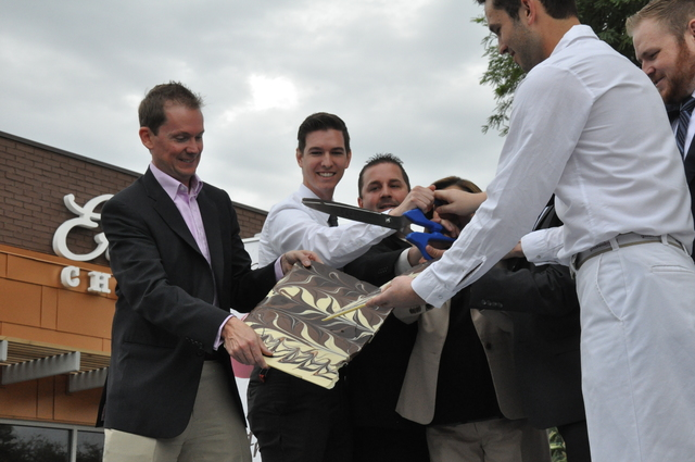 Ethel M general manager Oren Young (far left) helps cut a slab of gourmet chocolate in place of the traditional ribbon during the grand re-opening of the company's flagship store, Oct. 28  Photo b ...