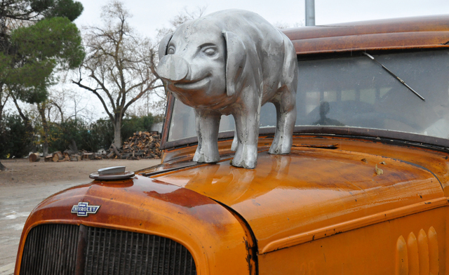 Robert Combs' R.C. Farms is filled with collectibles, including vintage automobiles, wagons, iron stoves and an array of pig imagery and objects. Photo by Buford Davis | Business Press