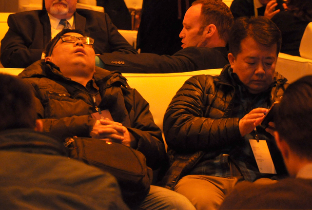 CES can be grueling, and it hasn't even begun. A guest waits for the unveiling of Faraday Future's product model at the World Market Center on Jan. 3. Photo by Buford Davis   Las Vegas Business Press