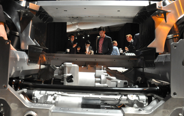A guest studies the frame of Faraday Future's FF 91 electric car, Jan. 3, at the World Market Center Pavilion. Photo by Buford Davis   Las Vegas Business Press
