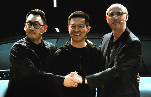 Faraday Future lead designer Richard Kim (left), principal financier Jai Yueting and Nick Sampson, senior vice president of product development and research, share the stage at the unveiling of th ...