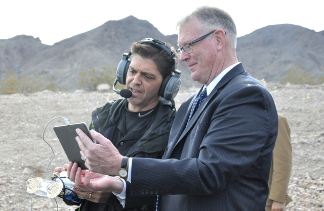 Henderson Mayor Andy Hafen, left, gets an aerial view of a drone flight demonstration via the unmanned vehicle's camera during the groundbreaking of HUVR. (Buford Davis/Las Vegas Business Press)