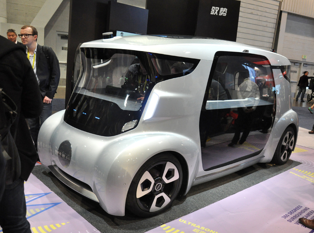 The box-like UISEE from Beijing-based USIEE Technologies features 360-degree view cameras, object detection sensors and self-parking capability. (Buford Davis/Las Vegas Business Press)