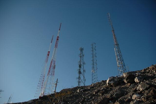 Broadcast transmission towers dot the ridge line on Mount Arden in Henderson.  (Photo credit: Fybush Media)