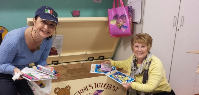 Stacy Wedding and her mom, Debbie Devald, fill Ernie's Toy Chest at St. Rose Siena-Pediatrics. Ernie's Toy Chest is a tribute to Wedding's dad, Ernie Devald, who volunteered countless hours in ...