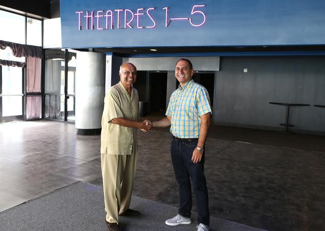 Rohit Joshi, left, shake hands with Alex Igelman, CEO of Millennial Esports inside Neonopolis' movie theater  Sep. 1, 2016. (Bizuayehu Tesfaye/Las Vegas Business Press)