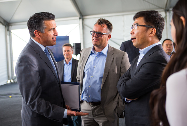 Gov. Brian Sandoval, from left, Faraday Future Vice President of Manufacturing Dag Reckhorn, and Ding Lei, Ding Lei, co-founder and global vice chairman of SEE Plan speak during the groundbreaking ...