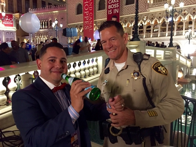 Anferni Rodriguez, Las Vegas Pellegrino brand director, has fun with a Las Vegas Metro police officer at the Bubble-Licious event marking the start of UNLVino at The Venetian. Bubble-Licious broug ...