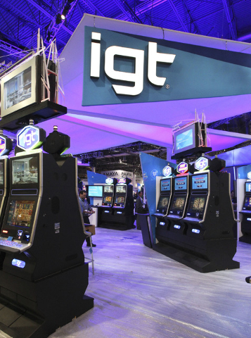 The new IGT logo is seen at the IGT booth at the G2E convention in the Sands Expo in Las Vegas, Monday, Sept. 23, 2013. G2E opens on Tuesday, Sept. 24, 2013. (Jerry Henkel/Las Vegas Review-Journal)