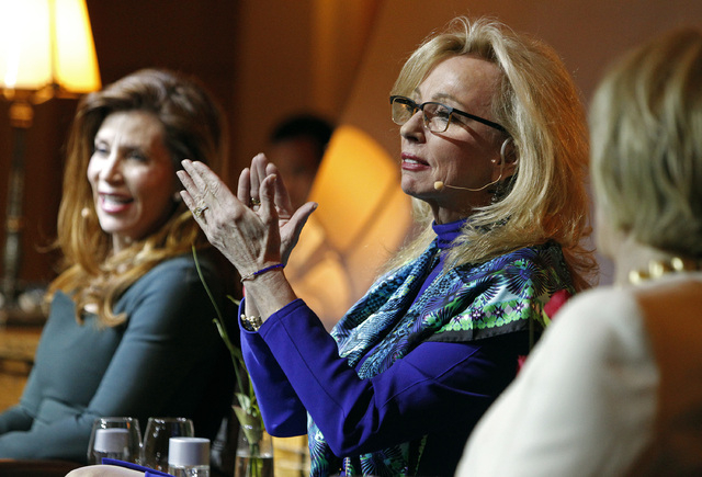 Jan Jones Blackhurst claps while sitting on stage at the Women in Gaming event at the Mob Museum in Las Vegas Wednesday, Feb. 19, 2014. (John Locher/Las Vegas Review-Journal)