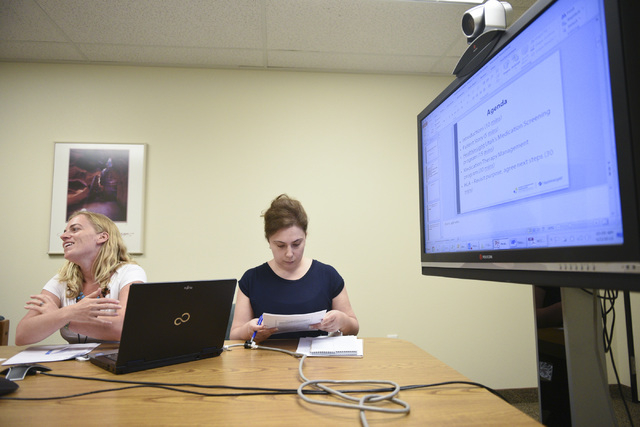 HealthInsight Nevada employees Jill Kreston, healthcare analyst, left, and Lilly Mazmanyan, administrative assistant, talk during a meeting in their Las Vegas office Tuesday, June 2, 2015. The gro ...