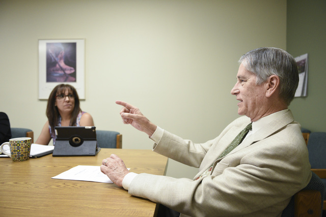 HealthInsight Nevada employees Jackie Buttaccio, quality improvement director, left, and Dr. Jerry Reeves, senior vice president of medical affairs, talk during a meeting in their Las Vegas office ...