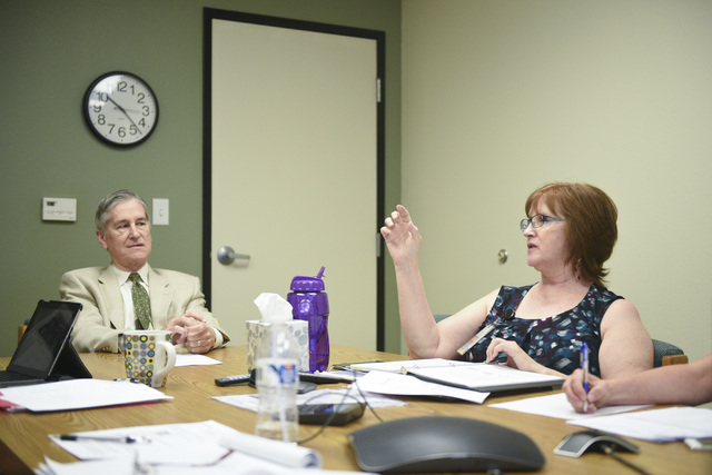 HealthInsight Nevada employees Dr. Jerry Reeves, senior vice president of medical affairs, left, and Donna Thorson, project coordinator, Jill Kreston, talk during a meeting in their Las Vegas offi ...