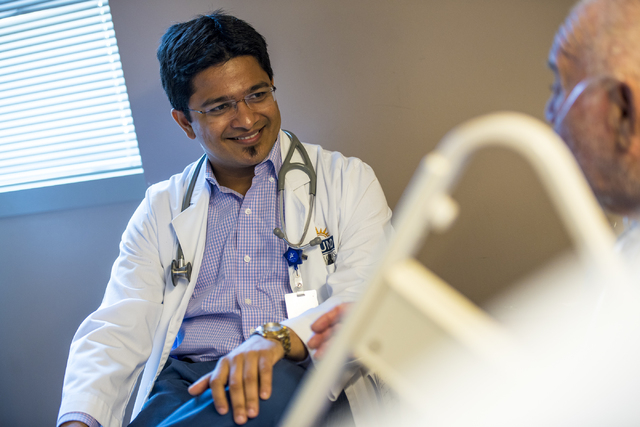 Dr. Vishal Shah, a hospitalist at Spring Valley Hospital Medical Center, talks with a patient at the hospital. (Joshua Dahl/Las Vegas Review-Journal)