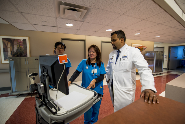 Dr. Shivesh Kumar, right, chief hospitalist at Spring Valley Hospital Medical Center, talks with Jennifer Bides and Mariane Reyes at Spring Valley Hospital Medical Center on Thursday, June 4, 2015 ...