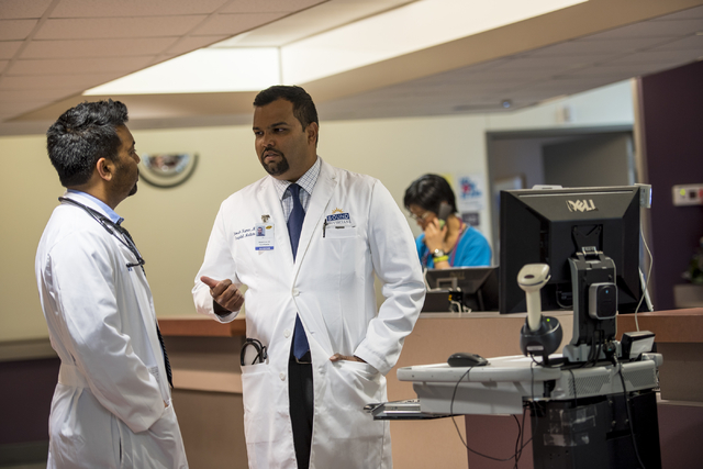 Dr. Shivesh Kumar, right, chief hospitalist at Spring Valley Hospital Medical Center, speaks with fellow hospitalist, Dr. Bobby Shaw at Spring Valley Hospital Medical Center on Thursday, June 4, 2 ...