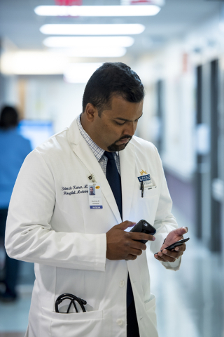Dr. Shivesh Kumar, chief hospitalist at Spring Valley Hospital Medical Center, checks his phone at Spring Valley Hospital Medical Center on Thursday, June 4, 2015. (Joshua Dahl/Las Vegas Review-Jo ...