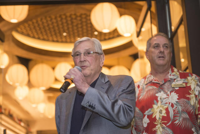 Bill Boyd, executive chairman of Boyd Gaming, addresses a crowd during the grand opening of California Noodle House, as David Lebby, vice president and general manager of the California Hotel and  ...