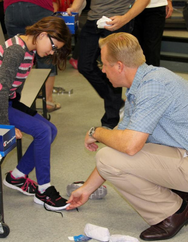 'Happy Feet'  Mitchell Horst, co-founder of Select Wealth Advisers and president of the Las Vegas Southwest Rotary, visited William Ferron Elementary May 17 with other Rotary members, continuing a ...