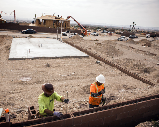 Jeff Scheid/Las Vegas BUSINESS PRESS Construction workers place rebar in a block wall at Richmond American Homes development in Providence May 5. The construction industry peaked in 2006 when it h ...