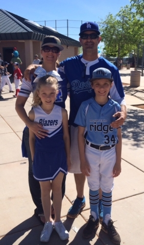 Shannon Petersen was among those cheering opening day at Mountain Ridge Little League. Here she's shown with husband Trevor, who's a coach; daughter Trinity, a cheerleader; and son Hayden, who ...