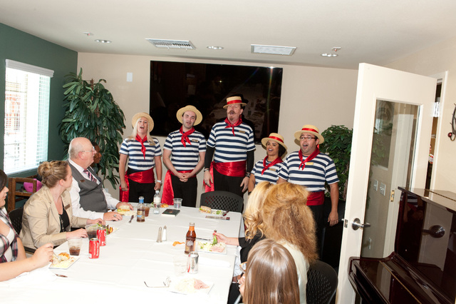The Venetian Gondoliers sing to to the Nevada Partnership for Homeless Youth clients and Las Vegas Sands employees during a lunch to celebrate the company's donation.  Photo Credit: Las Vegas Sand ...