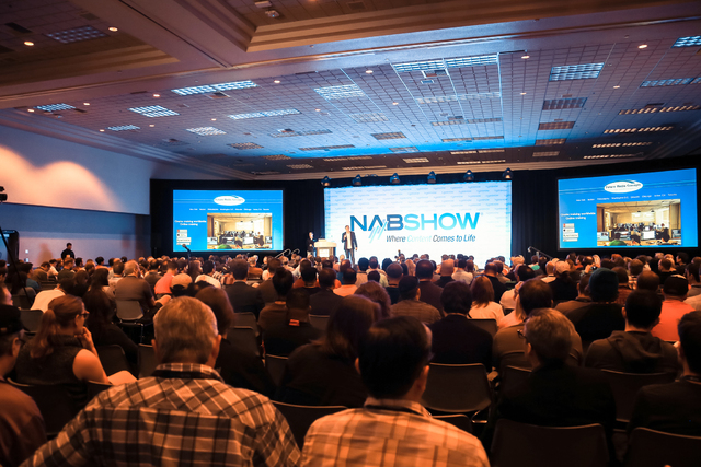 Huge crowds and discussions of significant broadcast technology topics are hallmarks of NAB week in Las Vegas. Here, attendees listen to the production keynote address at the 2015 show. (Courtesy, ...