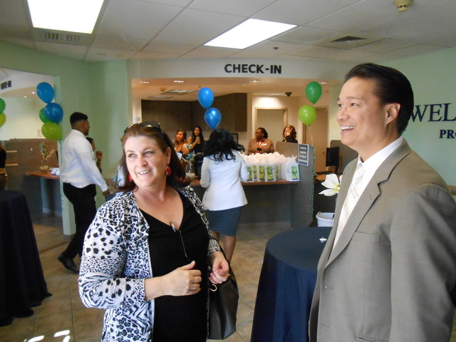 Psychiatrist Marian Orr talks with Well Care founder Marce Casal at the opening of the Well Care Services center at Tropicana Avenue and Boulder Highway.
