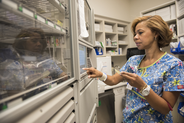 Registered nurse Lorna Livingston Armand goes through a procedure to make sure the right patient receives the right medication during her shift at the St. Rose Dominican Siena Campus in Henderson  ...