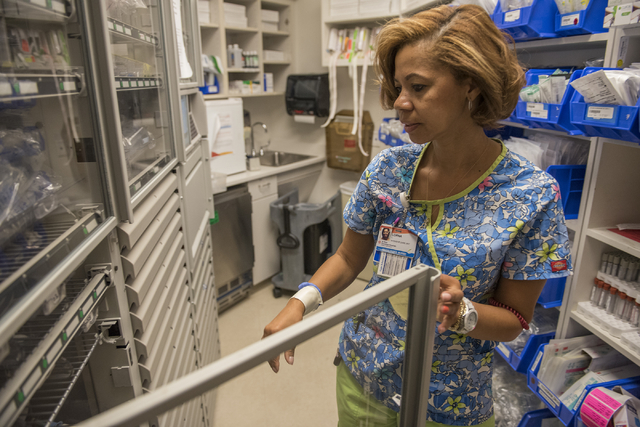Registered nurse Lorna Livingston Armand goes through a procedure to make sure the right patient receives the right medication during her shift at the St. Rose Dominican Siena Campus in Henderson. ...