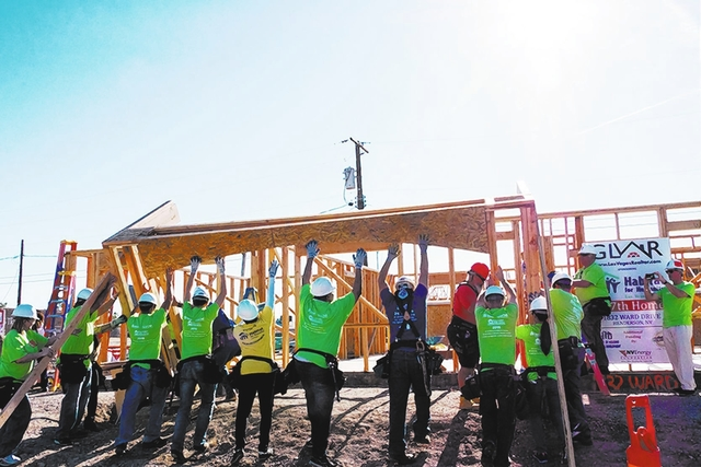 Courtesy In partnership with Habitat for Humanity Las Vegas, the Greater Las Vegas Association of Realtors dedicated a Habitat house to a local family in September.