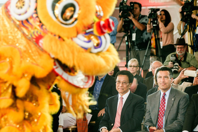 K.T. Lim, chairman and CEO of Genting Group, left, and Gov. Brian Sandoval watch the Resorts World Lion Dancers during the groundbreaking of the $4 billion Resorts World Las Vegas resort property, ...