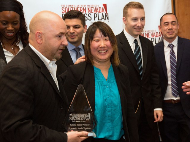 Jinger Zeng, center, COO and co-founder of Skyworks Aerial Systems, reacts with her team following the announcement they won the Dominic Anthony Marrocco Southern Nevada Business Plan Competition  ...