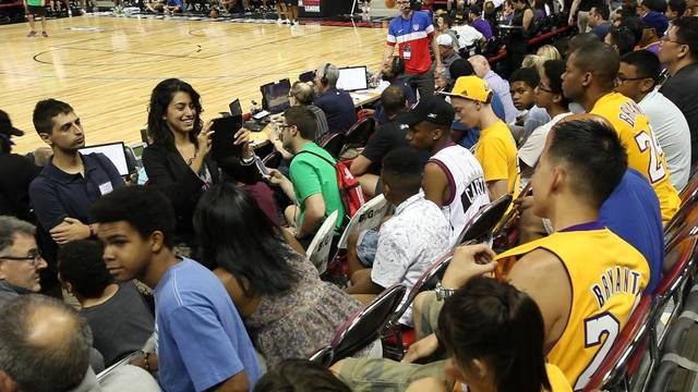 Students in the business class work on social media programs for players in the NBA Summer League. Courtesy