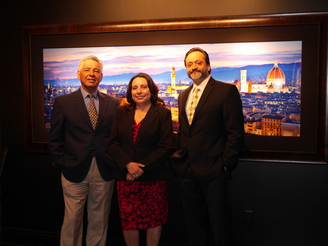 Joe Hernandez, left, president of the Nevada Hispanic Business Group, meet at the William Carr Gallery at Tivoli Village with Laura Nowlan, executive director at NHBG, and Orlando Gallegos, vice p ...