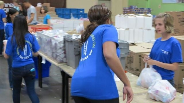 City National Bank colleagues take part in Three Square Food Bank's BackPack for Kids program May 19, to help fight hunger in Southern Nevada. A team of 30 helped fill 2,400 bags of food.