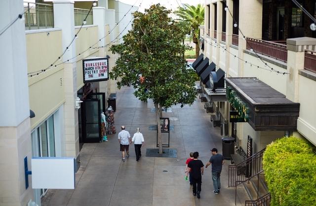People walk around Town Square in Las Vegas. Chase Stevens/Las Vegas Review-Journal Follow @csstevensphoto