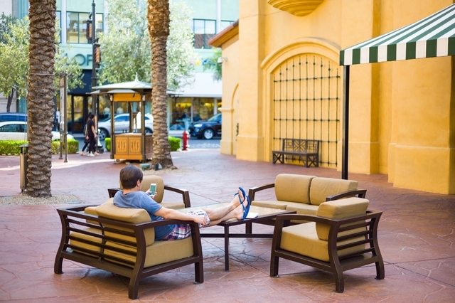 A man relaxes at Town Square in Las Vegas. Chase Stevens/Las Vegas Review-Journal Follow @csstevensphoto