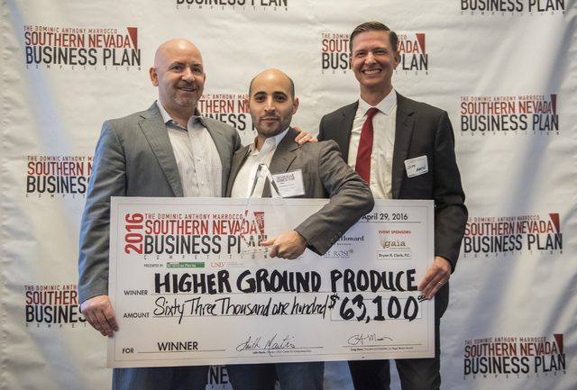 Jonathan Torn, center, winner of the 8th annual Dominic Anthony Marrocco Southern Nevada Business Plan Competition, accepts the check from contest sponsor Dominic Anthony Marrocco, left, and Leith ...