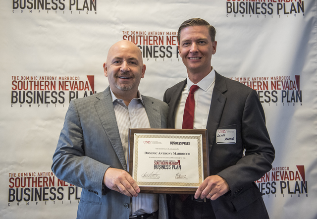 Dominic Anthony Marrocco, left, receives a certificate from Director of UNLV Center of Entrepreneurship Leith Martin, Ph.D. during the 8th annual Dominic Anthony Marrocco Southern Nevada Business  ...