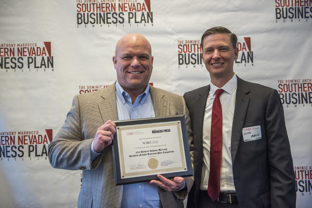 Bryce R. Wilson, left, receives a certificate from Director of UNLV Center of Entrepreneurship Leith Martin, Ph.D. during the 8th annual Dominic Anthony Marrocco Southern Nevada Business Plan Comp ...