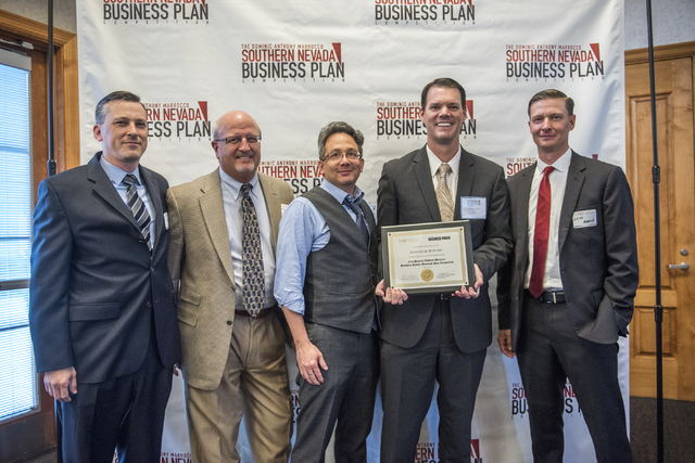 Director of UNLV Center of Entrepreneurship Leith Martin, Ph.D., right, presents a certificate to representatives of Howard and Howard law firm during the 8th annual Dominic Anthony Marrocco South ...
