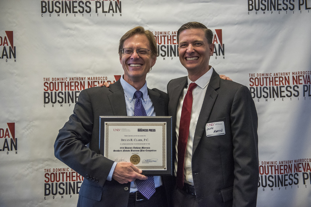 Bryan R. Clark, left, receives a certificate from Director of UNLV Center of Entrepreneurship Leith Martin, Ph.D. during the 8th annual Dominic Anthony Marrocco Southern Nevada Business Plan Compe ...