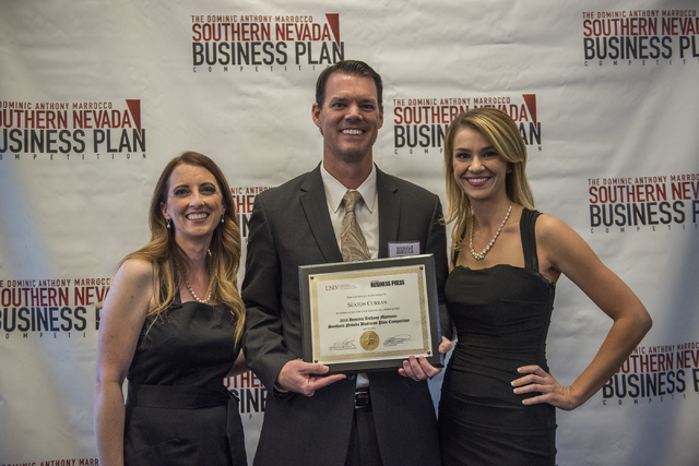 Seaton J. Curran, center receives a certificate from master of ceremonies Angela Douglas, left, and Liz Lewis during the 8th annual Dominic Anthony Marrocco Southern Nevada Business Plan Competiti ...