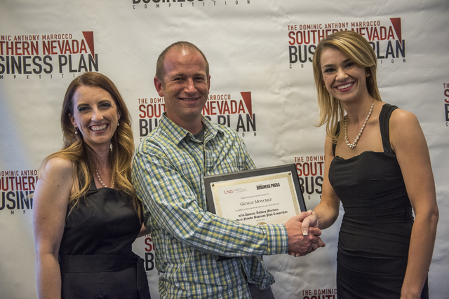 George Moncrief, center receives a certificate from master of ceremonies Angela Douglas, left, and Liz Lewis during the 8th annual Dominic Anthony Marrocco Southern Nevada Business Plan Competitio ...