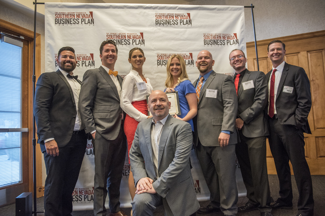 Dominic Anthony Marrocco, bottom, is seen posing with competition team FRP Innovations Pyrohalt during the 8th annual Dominic Anthony Marrocco Southern Nevada Business Plan Competition from the Fo ...